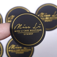 Cheap Luxury Gold Foil Stamping Black Round Custom Printing Logo Stickers wholesale