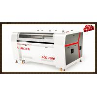 Cheap Water Cooling Auto Feeding Laser Cutting Machine With 1600x1000mm Working Area wholesale
