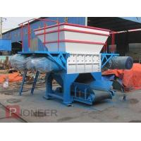 Waste tire shredder